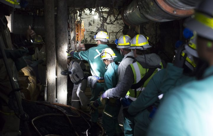 Miners underground in safety personal protective equipment (PPE)